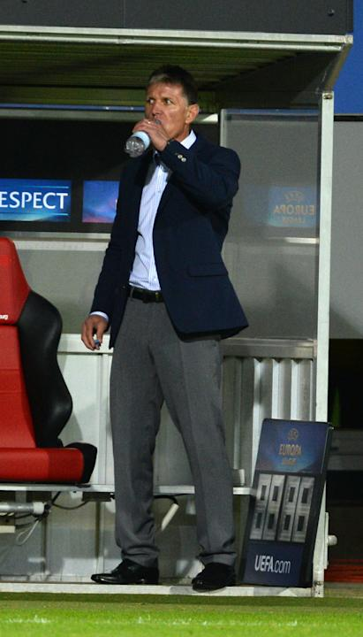 Headcoach Jaroslav Silhavy from Librerec drinks water during the UEFA Europa League Group H   soccer match between SC Freiburg and Slovan Liberec FC a n Freiburg, Germany,  Thursday Sept. 19,  2013
