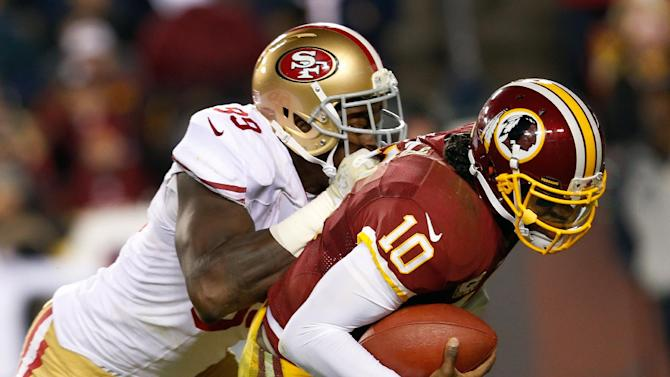 Washington Redskins quarterback Robert Griffin III is sacked by San Francisco 49ers outside linebacker Aldon Smith during the second half of an NFL football game in Landover, Md., Monday, Nov. 25, 2013. (AP Photo/Alex Brandon)