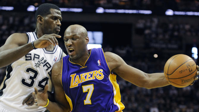 Los Angeles Lakers forward Lamar Odom, right, drives against San Antonio Spurs forward Antonio McDyess during the first half of an NBA basketball game in San Antonio, Sunday, March 6, 2011. (AP Photo/Bahram Mark Sobhani)