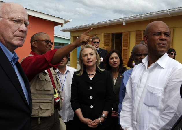 Secretary of State Hillary Rodham Clinton, center, accompanied by, from left, Sen. Patrick Leahy, D-Vt.,  Caracol Ekam Housing site engineer Mario Nicoleau, Labor Secretary Hilda Solis and Haitian Pre