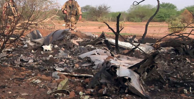 CLICK IMAGE for slideshow: This photo provided Friday July 25, 2014 by the French army shows soldiers at the site of the plane crash in Mali. French s...