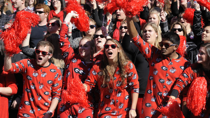 Pajama clad Georgia fans cheer their team as they come on the field to take on Georgia Tech at the start of an NCAA college football game, Saturday, Nov. 24, 2012, in Athens, Ga. (AP Photo/John Amis)