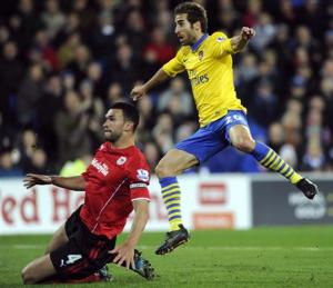 Arsenal's Mathieu Flamini scores a goal against Cardiff City during their English Premier League soccer match in Cardiff