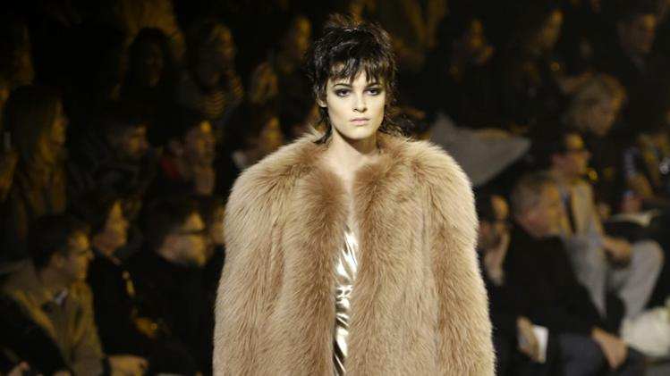 A model walks the runway during the Marc Jacobs Fall 2013 fashion show Fashion Week in New York, Thursday, Feb. 14, 2013.  (AP Photo/Kathy Willens)
