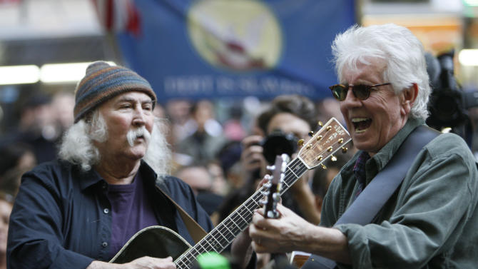 David Crosby, left,  and Graham Nash perform at the Occupy Wall Street encampment at Zuccotti Park,  Tuesday, Nov. 8, 2011 in New York.  (AP Photo/Mary Altaffer)