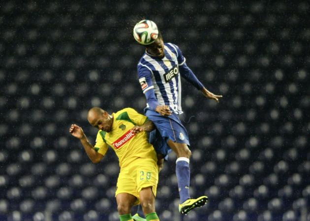 Porto's Abdoulaye jumps for the ball with Pazos de Ferreira's Del Valle during their Portuguese Premier League soccer match at Dragao stadium in Porto