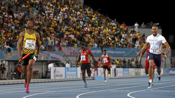 Jamaica's Warren Weir crosses the finish line as Jamaica wins the 4x200 relay race at the IAAF World Relays Championships in Nassau