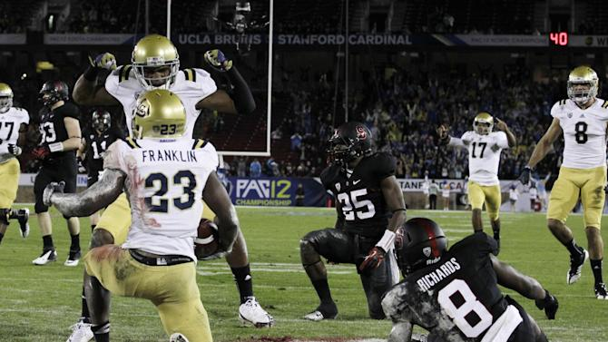 UCLA running back Johnathan Franklin (23) celebrates with teammates in the end zone after his 51-yard touchdown run against Stanford during the first half of the Pac-12 championship NCAA college football game in Stanford, Calif., Friday, Nov. 30, 2012. (AP Photo/Tony Avelar)