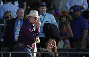 California Chrome co-owner Steve Coburn calls from the grandstand at Belmont Park. (AP Photo)