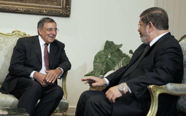Egypt's newly elected President Mohammed Morsi, right, meets with US defense Secretary Leon Panetta in Cairo, Egypt, Tuesday, July 31, 2012. Panetta is seeking assurances from Egypt's new Islamist government that the country will remain a military partner at a time of political tumult in the Middle East and growing worry about Iran's nuclear ambitions. (AP Photo/Amr Nabil)