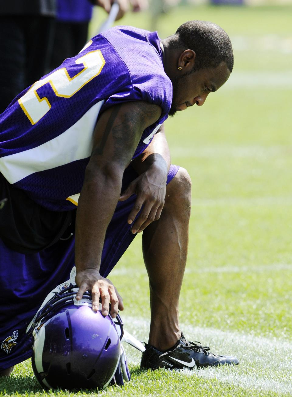 Minnesota Vikings wide receiver Percy Harvin kneels along the sidelines during the first day of NFL football minicamp, Tuesday, June 19, 2012, in Eden Prairie, Minn. Harvin earlier told reporters he is upset with the team but did not elaborate. (AP Photo/Jim Mone)