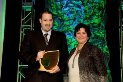 Robert Sottile, store manager at Lowe's of Henderson, Nev., receives the 2013 WaterSense Sustained Excellence award from Mary Ann Dickinson, president and CEO of the Alliance for Water Efficiency.