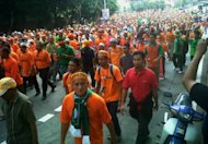 Orange wave marches on Istana Negara in bid to save Felda