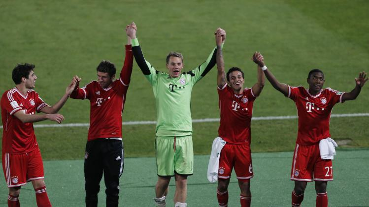 Germany's Bayern Munich goalkeeper Manuel Neuer celebrates with his team mates after they won their 2013 FIFA Club World Cup final soccer match against Morocco's Raja Casablanca at Marrakech stadium