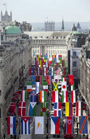 A view of Regent Street in London flying flags from around the globe as it welcomes the world to celebrate the London 2012 games, London, Friday, June 15, 2012. (AP Photo/John Phillips/PA) UNITED KINGDOM OUT