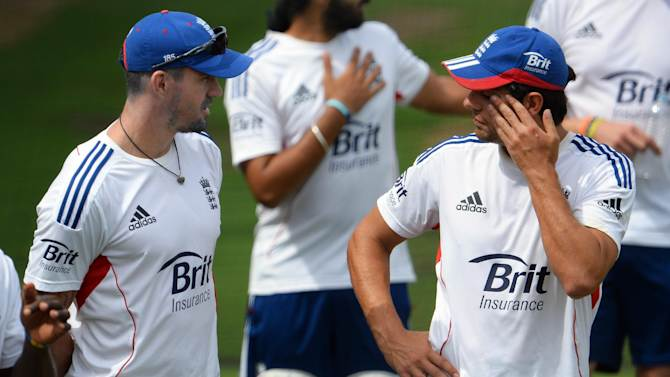 England cricket captain Alastair Cook (R) chats with teammate Kevin Pietersen (L) during a training session in Melbourne on December 25, 2013