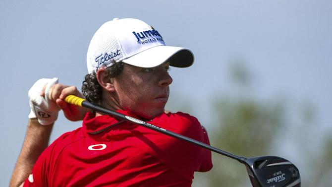 Rory McIlroy of Northern Ireland tees off on the 9th hole during the final round of the DP World Golf Championship in Dubai, United Arab Emirates, Sunday, Nov. 25, 2012.  (AP Photo/Stephen Hindley)