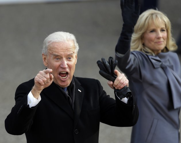 Vice President Joe Biden reacts with his wife, Jill, as they walk down Pennsylvania Avenue en route to the White House, Monday, Jan. 21, 2013, in Washington. Thousands  marched during the 57th Preside