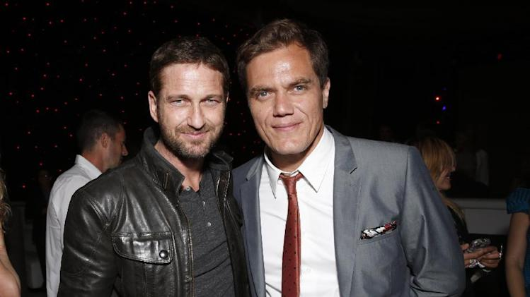 IMAGE DISTRIBUTED FOR MILLENNIUM - Gerard Butler, left, and Michael Shannon attend the DeLeon Tequila Premiere of The Iceman After Party on Monday, April 22, 2013 in Los Angeles. (Photo by Todd Williamson/Invision for Millennium/AP Images)