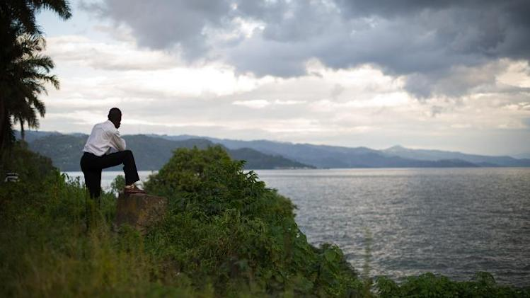 A man looks towards the hills of Rwanda on the eastern edge of Lake Kivu from the Democratic Republic of the Congo's eastern city of Goma on May 28, 2012