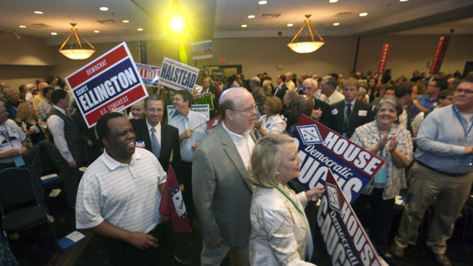 In this photo taken Aug. 18, 2012, legislative candidates parade past delegates at the Democratic Party of Arkansas state convention in North Little Rock, Ark. When state Democrats talk about their 2012 priorities, they are focusing on races that could decide whether the Legislature falls to Republicans for the first time since Reconstruction. (AP Photo/Danny Johnston)