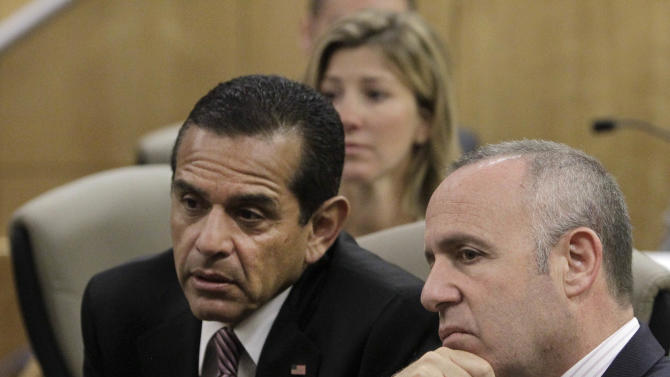 Los Angeles Mayor Antonio Villaraigosa, left, and Senate President Pro Tem Darrell Steinberg, D-Sacramento, listen as members call for the passage of Steinberg's measure to outlaw rifles with detachable magazines,  while appearing before the Senate Public Safety Committee in Sacramento, Calif., Tuesday, April 16, 2013.  Steinberg's bill,  SB374,  is one of seven bills that Senate Democrats have proposed to tighten California's already strict gun control laws.(AP Photo/Rich Pedroncelli)