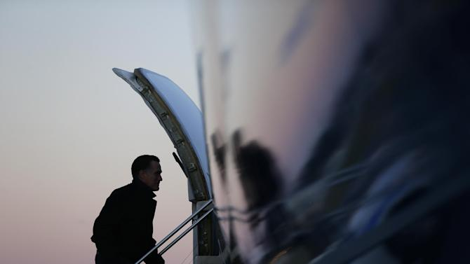 Republican presidential candidate and former Massachusetts Gov. Mitt Romney boards his plane in Norfolk, Va., Friday, Nov. 2, 2012, as he travels to campaign events in Milwaukee, Wis. (AP Photo/Charles Dharapak)