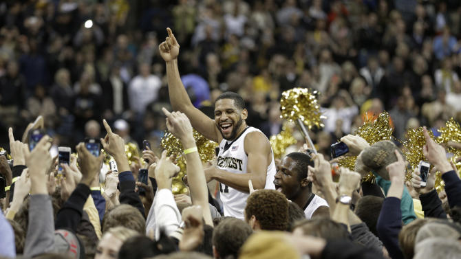 Wake Forest's C.J. Harris, center, celebrates with fans after their 80-65 win over second-ranked Miami in an NCAA college basketball game in Winston-Salem, N.C., Saturday, Feb. 23, 2013. (AP Photo/Chuck Burton)