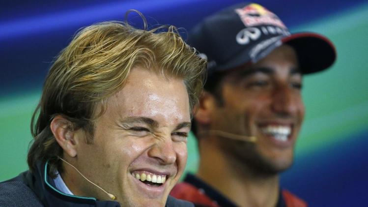 Mercedes Formula One driver Rosberg of Germany and Red Bull Racing Formula One driver Ricciardo of Australia smile during a news conference ahead of the weekend's Belgian F1 Grand Prix in Spa-Francorchamps