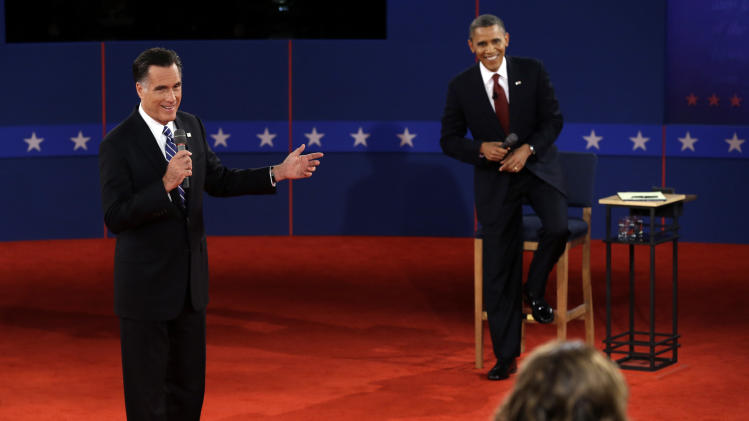 Republican presidential nominee Mitt Romney and President Barack Obama answer a question during the second presidential debate at Hofstra University, Tuesday, Oct. 16, 2012, in Hempstead, N.Y. (AP Photo/Charlie Neibergall)
