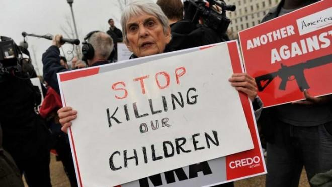 A protester demonstrates in front of the NRA lobbying offices in Washington, D.C., on Dec. 17.