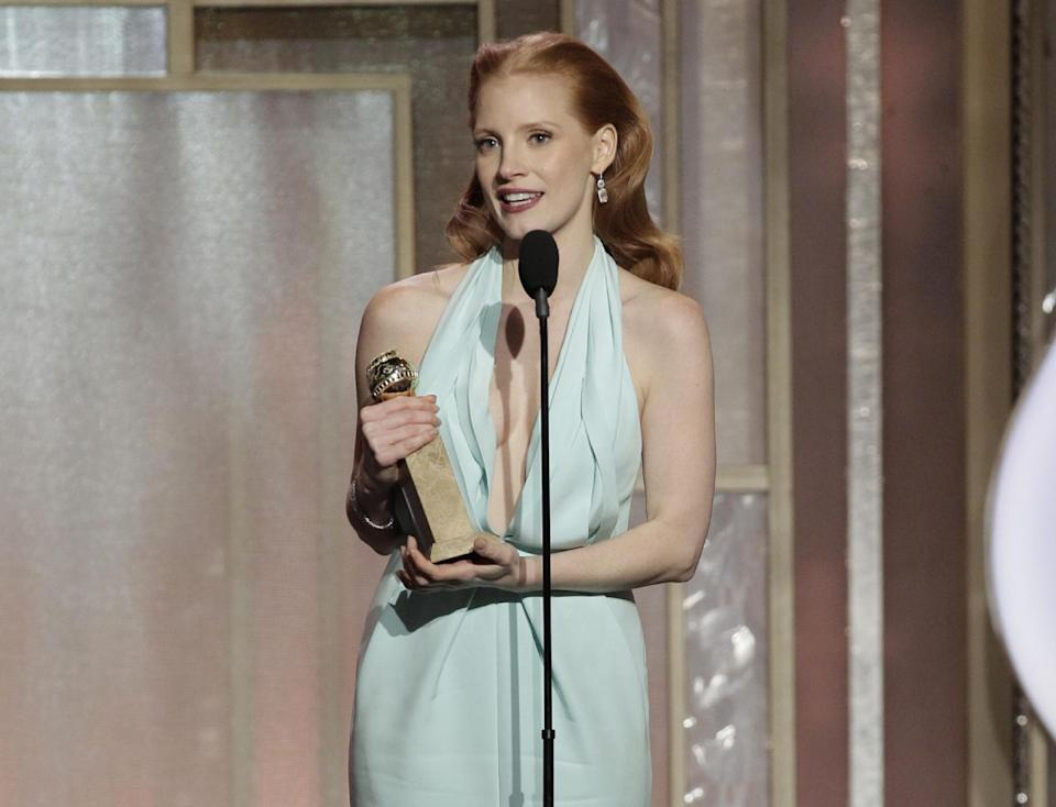 "This image released by NBC shows Jessica Chastain with her award for best actress in a motion picture drama for her role in ""Zero Dark Thirty"" during the 70th Annual Golden Globe Awards at the Beverly Hilton Hotel on Jan. 13, 2013, in Beverly Hills, Calif.  (AP Photo/NBC, Paul Drinkwater)"