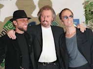"(L-R) Maurice, Barry and Robin Gibb, of the Bee Gees, at a music festival in San Remo in 1997. Barry, Maurice and Robin scaled the heights of the pop world in the 1970s with disco hits including ""How Deep Is Your Love"", ""Stayin' Alive"", and ""Night Fever"""