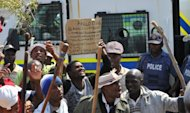 Striking workers of the Anglo American Platinum (Amplats) move from shaft to shaft to call on their colleagues to stop working in Rustenburg, on September 12. Two of the world's top mining giants toughened their line against striking S.African workers, with one threatening to sack employees and the other warning of plant closures if stoppages continued