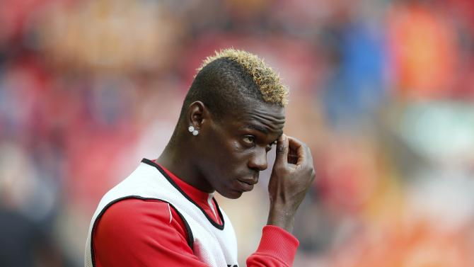 Liverpool's Mario Balotelli walks out to warm up before their English Premier League soccer match against Hull at Anfield in Liverpool