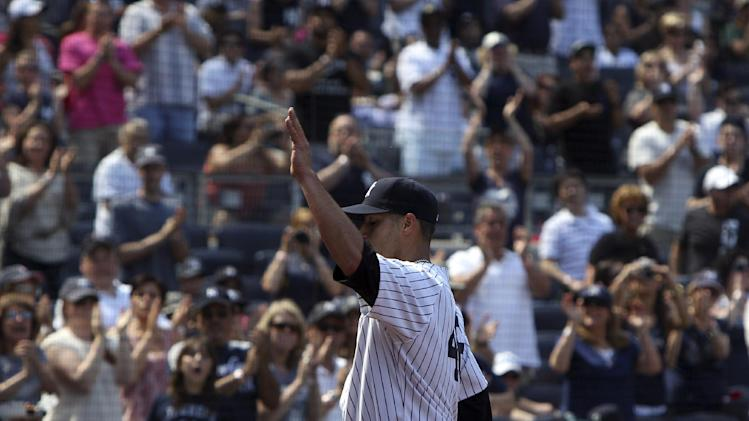New York Yankees starting pitcher Andy Pettitte acknowledges the applauding crowd as he leaves the game during the seventh inning of a baseball game against the Seattle Mariners at Yankee Stadium in New York, Sunday, May 13, 2012. (AP Photo/Seth Wenig)