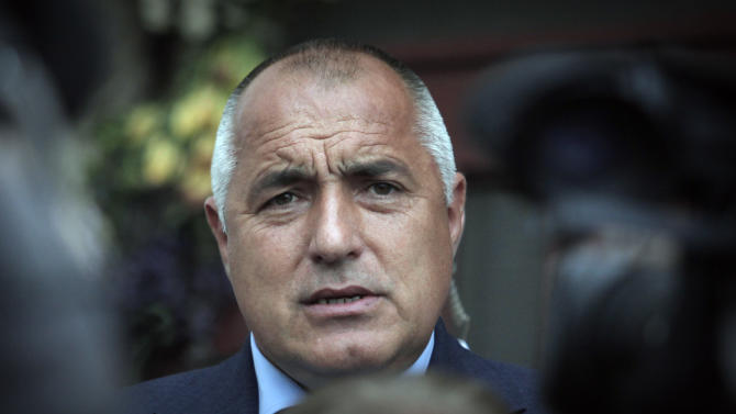 Boiko Borisov, former Prime Minister and leader of center-right GERB party talk to journalists, after casting his vote in Bankya, Bulgaria, Sunday May 12, 2013. Bulgarians are voting Sunday in parliamentary elections with no party expected to win a majority to form a government, fueling fears about more political and economic instability in the country. (AP Photo/Valentina Petrova)