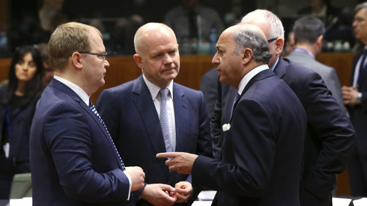 Estonia's Foreign Minister Paet, Britain's Foreign Secretary Hague and France's Foreign Minister Fabius attend a European Union foreign ministers meeting in Brussels