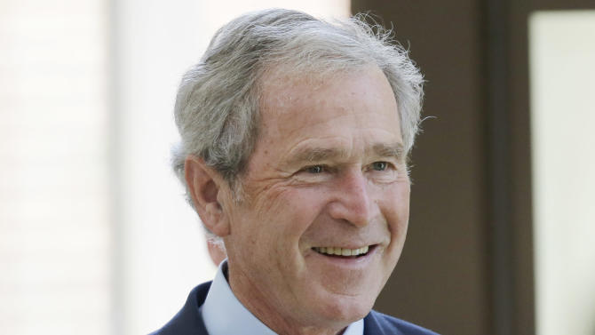 Former President George W. Bush arrives at the signing ceremony for the joint use agreement between the National Archive and the George W. Bush Presidential Center Wednesday, April 24, 2013, in Dallas. Bush and his wife, Laura, attended Wednesday's ceremony in Dallas the day before the official dedication of the George W. Bush Presidential Center. The George W. Bush Foundation raised the money to build the center. The foundation donated the library and museum portion of the center to the National Archives, which provides access to presidential records, documents, historical materials and artifacts over time. (AP Photo/David J. Phillip)