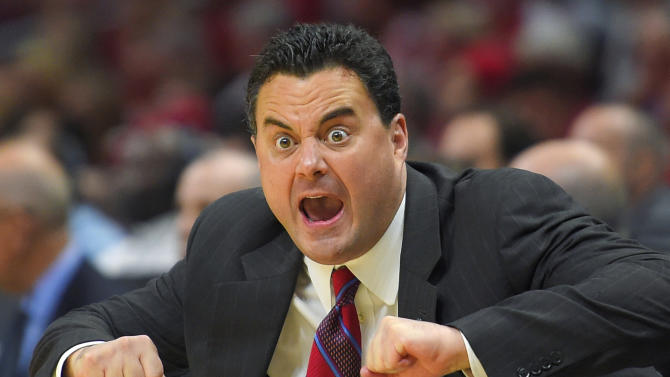 Arizona head coach Sean Miller calls to his team during the first half of a college basketball regional final against Wisconsin in the NCAA Tournament, Saturday, March 28, 2015, in Los Angeles. (AP Photo/Mark J. Terrill)