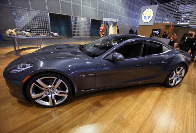 FILE - In this Nov. 18, 2010 file photo, Fisker Automotive's Fisker Karma, a sports luxury plug-in hybrid car, sits on display at the 2010 Los Angeles Auto Show in Los Angeles. Fisker says Saturday, Aug. 18, 2012, it is recalling the Karma sedan to fix cooling fans that can catch fire. (AP Photo/Damian Dovarganes, File)