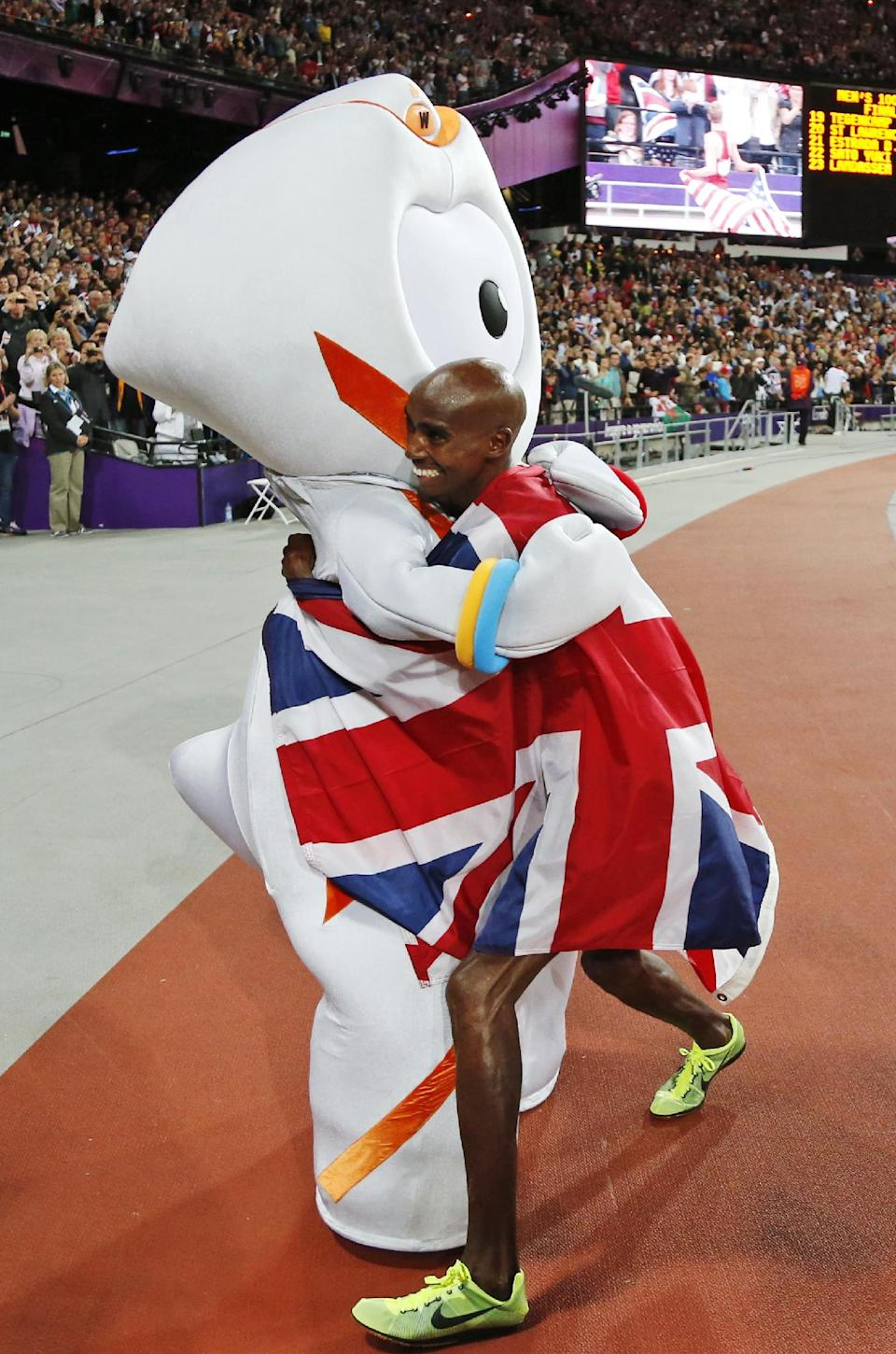 Britain's Mo Farah, right, embraces Wenlock, the games mascot, after winning gold in the men's 10,000-meter during the athletics in the Olympic Stadium at the 2012 Summer Olympics, London, Saturday, Aug. 4, 2012. (AP Photo/Matt Dunham)