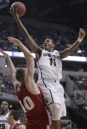 Michigan State guard Keith Appling (11) goes up for a shot against Wisconsin center Jared Berggren (40) in the first half of an NCAA college basketball game in the semifinals of the Big Ten Conference tournament in Indianapolis, Saturday, March 10, 2012. (AP Photo/Michael Conroy)