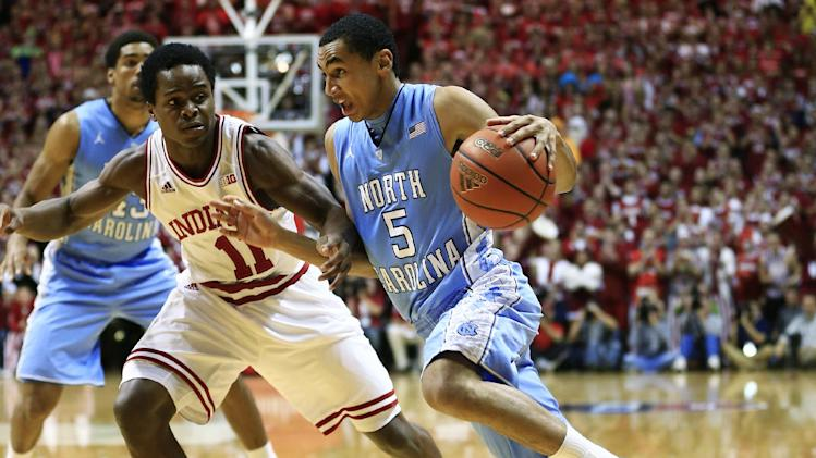 North Carolina's Marcus Paige (5) drives to the basket against Indiana's Yogi Ferrell during the first half of an NCAA college basketball game, Tuesday, Nov. 27, 2012, in Bloomington, Ind. (AP Photo/Darron Cummings)
