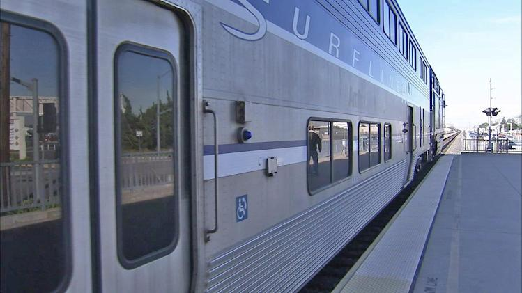 Holiday travelers trade car keys for train tickets