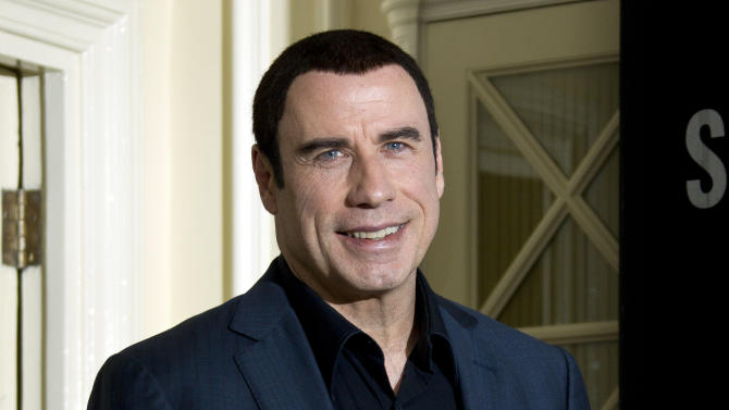 US actor John Travolta  arrives at the photo call for 'Savages', at a central London hotel, Wednesday, Sept. 19, 2012. (AP Photo/Joel Ryan)
