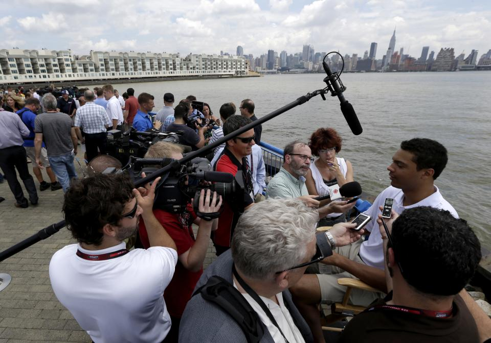 Defender Seth Jones, right, talks during a news conference introducing the top prospects going into Sunday's NHL hockey draft, Friday, June 28, 2013, in Weehawken, N.J. The draft will be held June 29 at Prudential Center in Newark, N.J. (AP Photo/Julio Cortez)