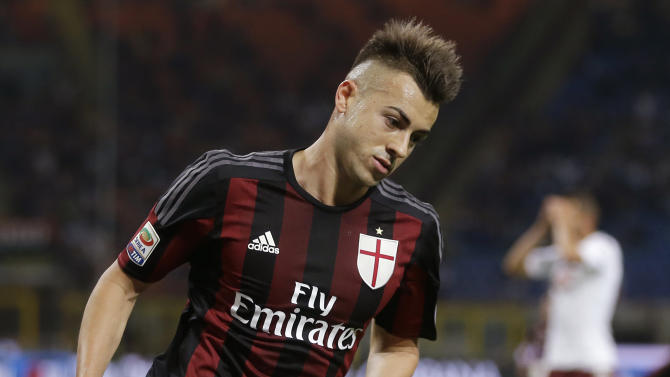AC Milan's Stephan El Shaarawy celebrates after scoring during the Serie A soccer match between AC Milan and Torino at the San Siro stadium in Milan, Italy, Sunday, May 24, 2015. (AP Photo/Antonio Calanni)