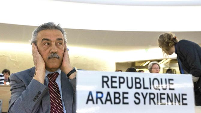 Faysal Khabbaz Hamoui, Ambassador of the Permanent Representative Mission of Syrian Arab Republic to Geneva, gestures  prior the 23rd session of the Human Rights Council, at the European headquarters of the United Nations in Geneva, Switzerland, Monday, May 27, 2013. The Unites States, Qatar and Turkey have asked the U.N.'s top human rights body to hold an urgent debate on the ways to end the civil war in Syria, and to hold accountable those responsible for killing thousands of civilians.  Syria's Ambassador Faysal Khabbaz Hamoui objected to Monday's request, saying it comes from nations that support the rebels who have been battling the regime of Syria's President Bashar Assad since March 2011. U.N. Human Rights Council President Remigiusz Henczel says the council will decide Tuesday whether to hold the debate Wednesday.  (AP Photo/Keystone,Salvatore Di Nolfi)