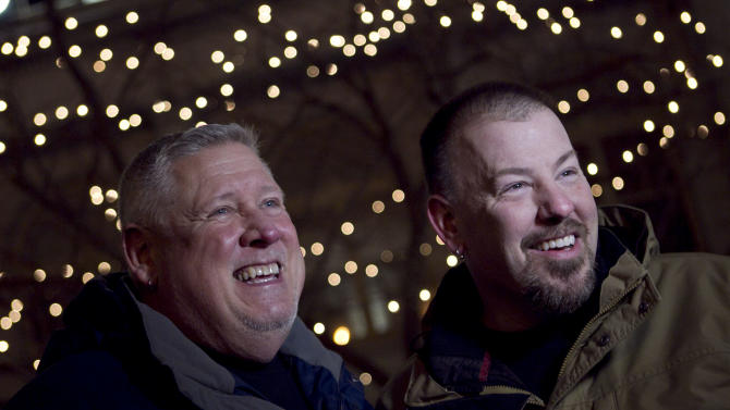Michael Snell, left, and Steven Bridges speak to a reporter, Friday, Dec. 28, 2012, outside City Hall where they plan to obtain a marriage license, in Portland, Maine. Same-sex couples in Maine will be allowed to marry as a new law goes into effect at 12:01 AM Saturday, Dec. 29, 2012.(AP Photo/Robert F. Bukaty)